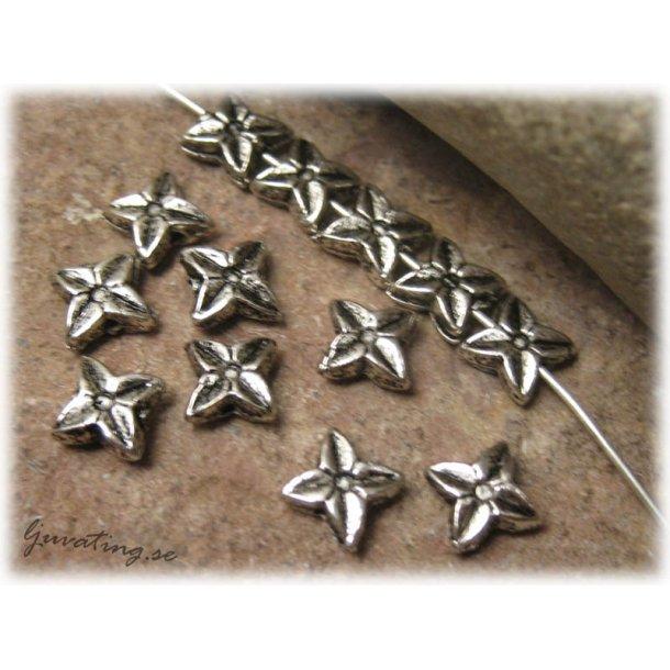Blomstjärna i metall 30-pack ca 9 mm