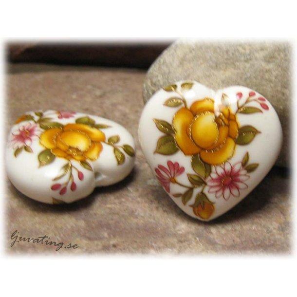 Tenshapärla vitt hjärta med gul ros ca 23x22 mm