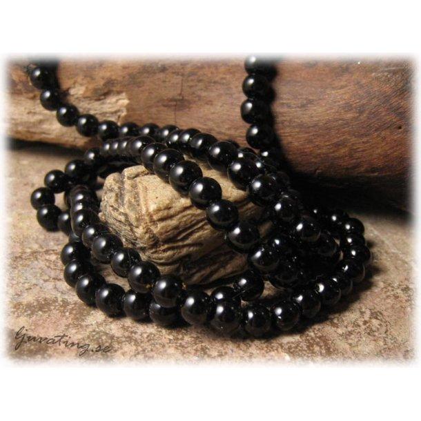 Pärlor i glas rund svart 1 hel sträng ca 6 mm