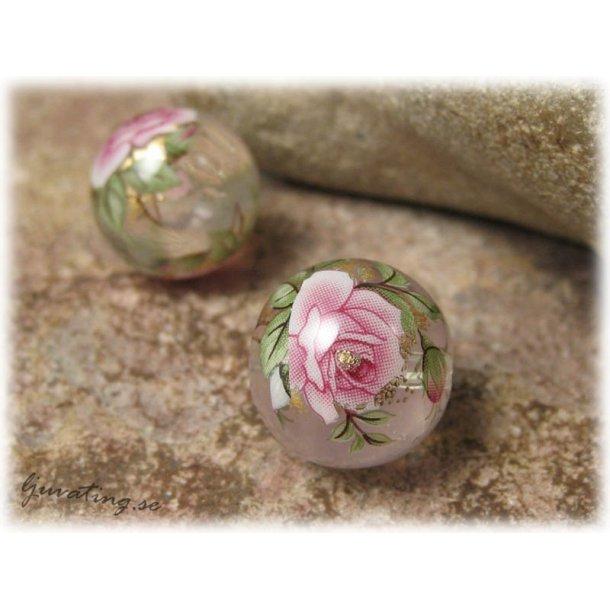 Rund Tensha clear transp med rosa ros ca 14 mm