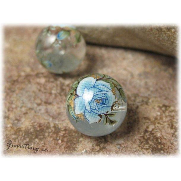 Rund Tensha clear transp med blå ros ca 14 mm