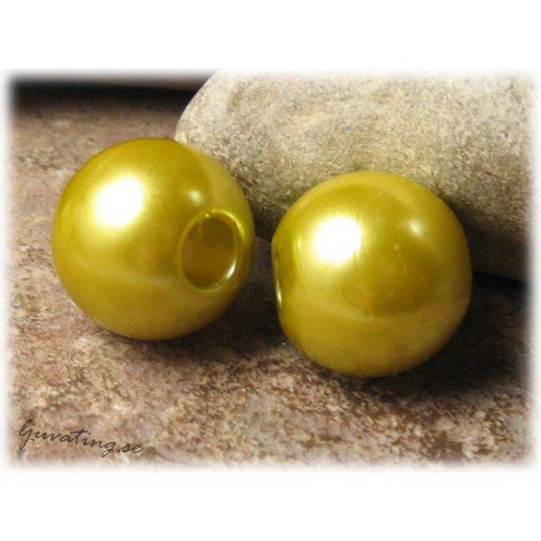 Stor pärla i syntet olivguld med stort hål ca 20mm