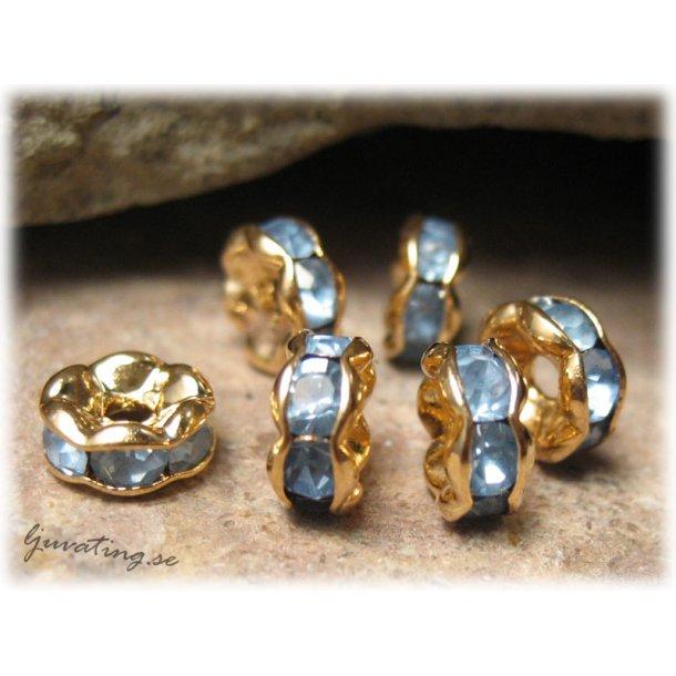 Guldig rondell med blå Rhinestone ca 6 mm