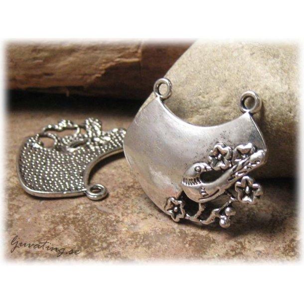 Hänge i metall med 2 öglor motiv fågel ca 32x28 mm