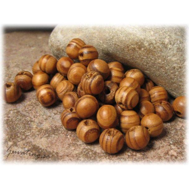 Runda träpärlor i bruna nyanser 50-pack 8 mm