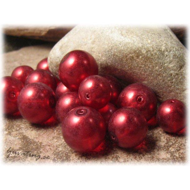 Mix röda transparenta vaxade 9-16 mm ca 50 gram