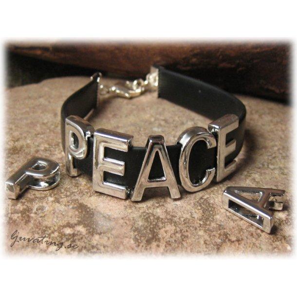 Sliders med ordet PEACE i metall hål ca 10x2 mm