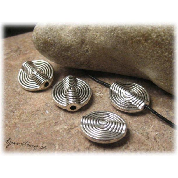 Platt rund i metall mönster spiral ca 15 mm
