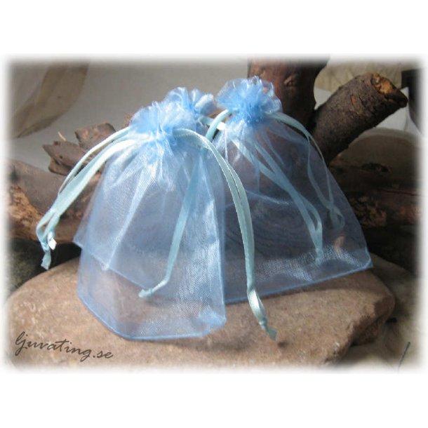 Smyckepåse blå enfärgad ca 12x10 cm