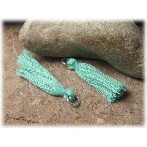 Liten turkosgrön tofs tassel med ring ca 32 mm