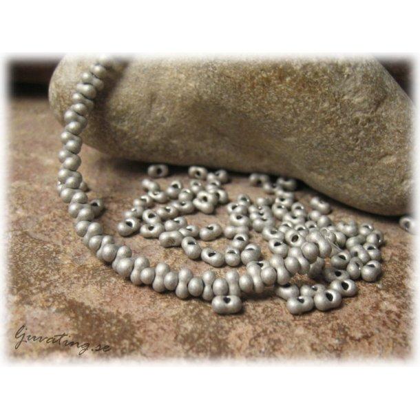 Grafitgrå farfalle pärla ca 4x2 mm