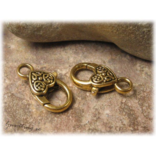 Klolås antik guldfärgat mönstrat hjärta ca 26x14mm